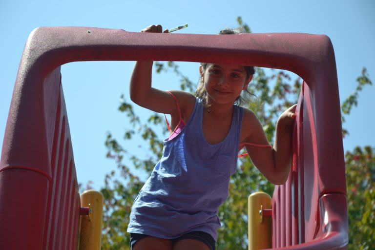 Girl on slide - Resident of Red Door Housing