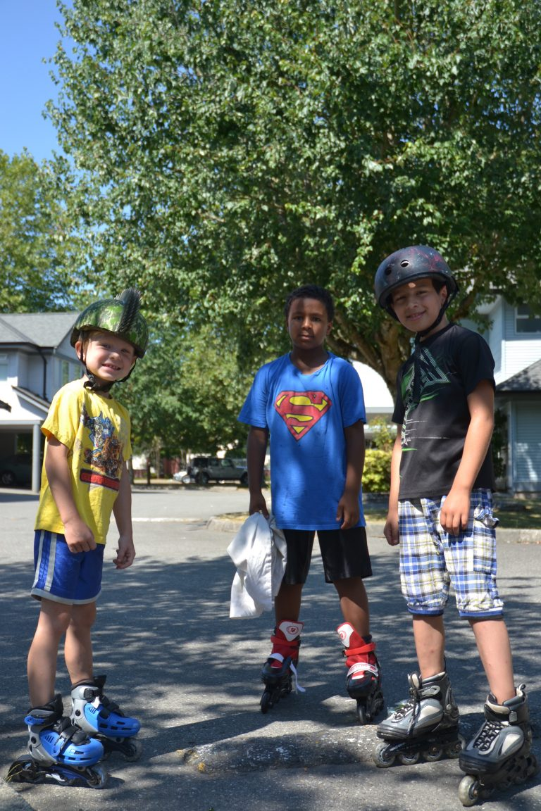 Boys rollerblading - Residents of Red Door Housing
